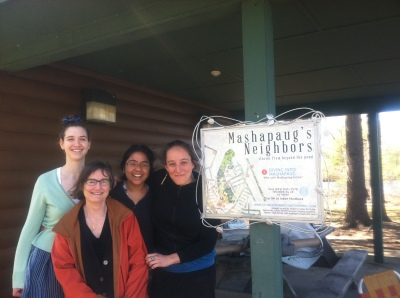 An photograph of the signs created by the design team at the Community Boathouse on Mashapaug Pond.
